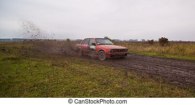 Red sport car drive on the dirt