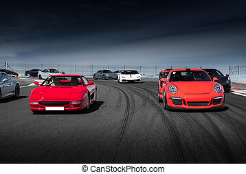 Red sport cars drive on the road