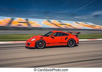 Red sport class car high speed drive