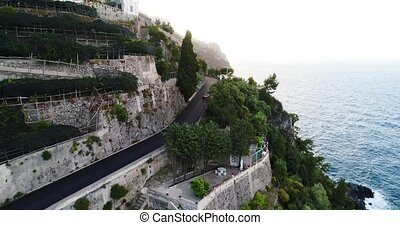 red sport convertible car moving in Amalfi coast