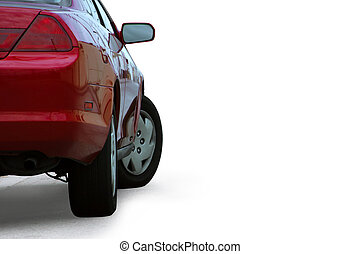 Red sporty car detail  isolated on white background and outlined with a clipping path.