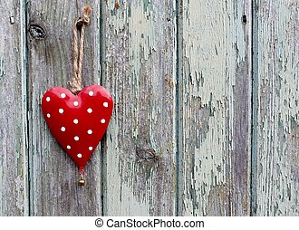 Red spotty heart on grunge background
