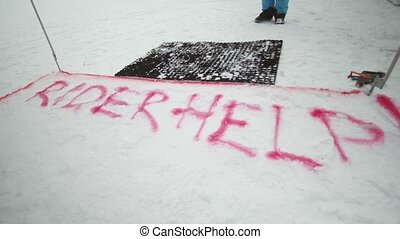 Red spray mark for snowboarder on trail. Snowy mountain. Contest. Ski resort. Challenge. Competition