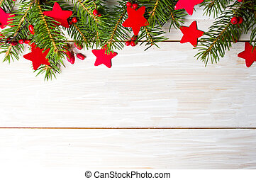 Red star shape decoration and fir tree with copyspace