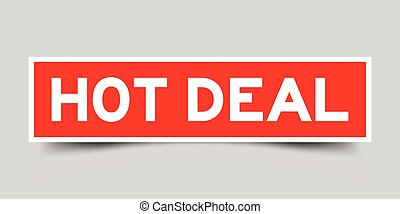 Red sticker with word hot deal on gray background