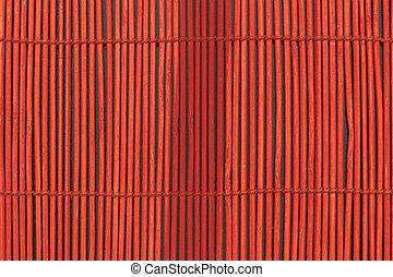 Red Sticks in Dark Background