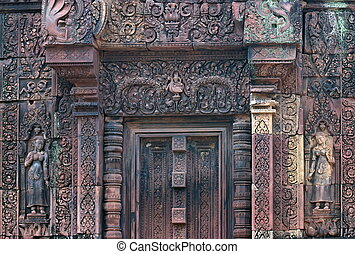 Red stone carving of the Banteay Srei Temple in the Angkor....
