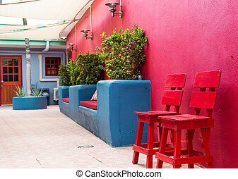 Red Stools on Wall