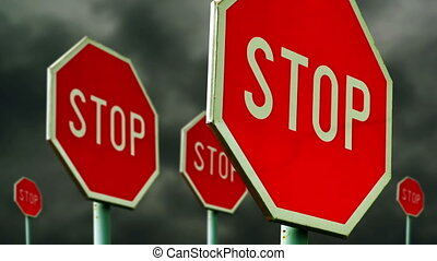 Red stop signs on the street. Roadside traffic signs for...