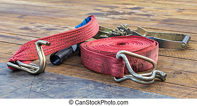 Red Strap and Ratchet - Red strap and ratchet on a truck...
