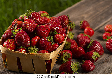 red strawberries on a wooden table