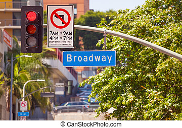 Red street light and Broadway sign on Los Angeles