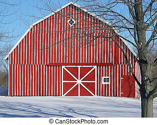 red striped barn in winter - Red and white striped barn in...