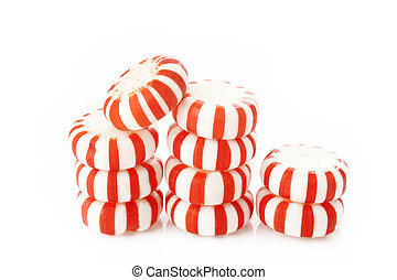 Red striped peppermints on a white background