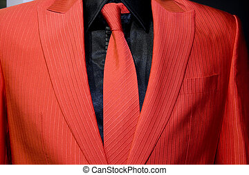 red suit and tie