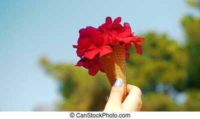 Red summer bouquet in waffle cone - Close-up shot of womans...