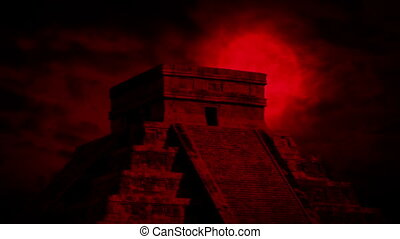 Red Sun Behind Ancient Temple - Huge red sun behind Aztec...