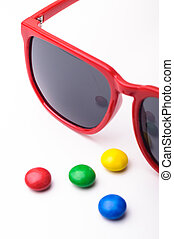 Red sunglasses and candys. - Red sunglasses and candys...