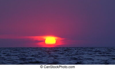 Red sunset at sea
