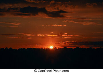 Red sunset. Beautiful evening sky. Orange rays of the sun