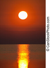 Red sunset over a sea surface