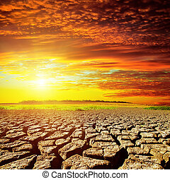 red sunset over cracked desert