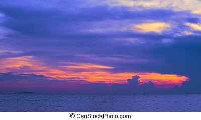 red sunset purple dark red sky and cloud moving on sea