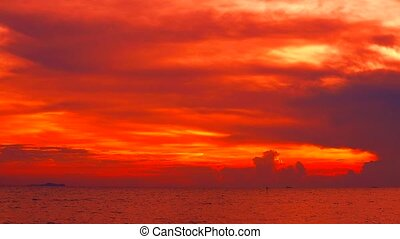red sunset red dark red sky and cloud moving on sea
