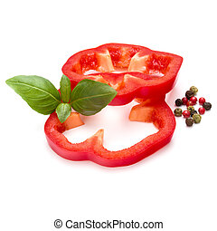 Red sweet bell pepper slices and basil leaves isolated on white background cutout
