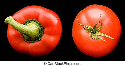 Red sweet pepper and tomato isolated on black background