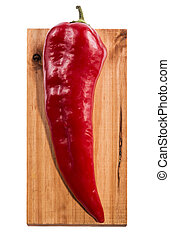 Red sweet pepper on a wooden board