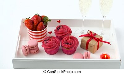 red sweets and champagne in st valentines day - st...