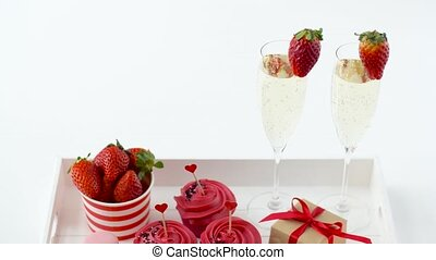 red sweets and champagne in st valentines day - valentines...