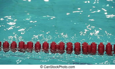 red lane marker empty swimming pool slow motion, close to