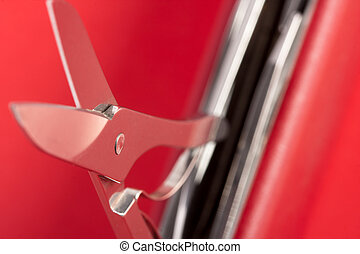 Red Swiss army knife with open scissors