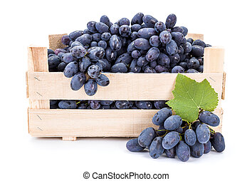 Red table grapes (Vitis) in wooden crate