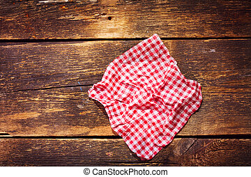 red tablecloth on wooden table