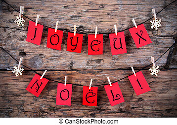 Red Tags Hanging on a Line with the French Words Joyeux No?l on it which means Merry Christmas