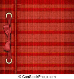 Red tartan cover for album with ribbons and bow