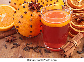 red tea and orange decorated with cloves