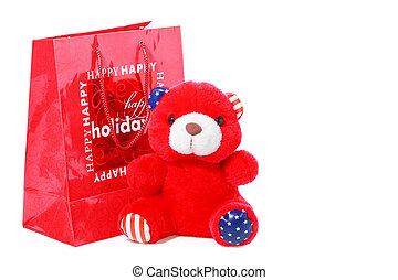 Red teddy bear as christmas gift isolated on white