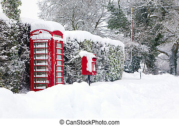 Red telephone and post box in the snow - A red British...