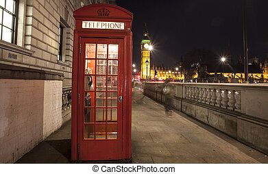 Red Telephone Booth at night, Big Ben in the distance, London, UK
