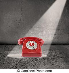 red telephone in the spotlight