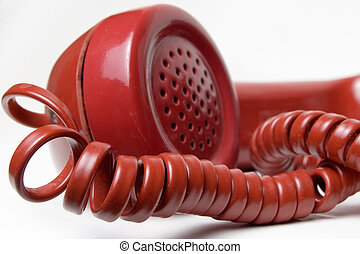 Red telephone receiver - close up of old antique style red...