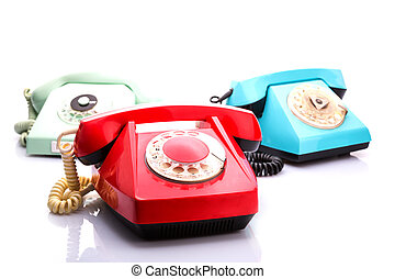 Red telephones on white