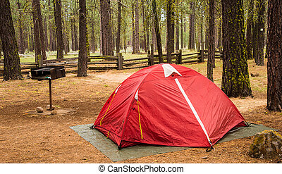 Red Tent Rainy Day - A red tent shelters campers on a rainy ...