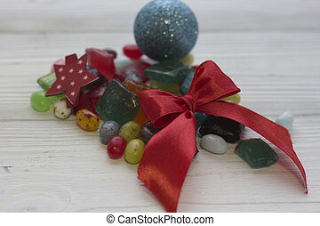 Red textile bow on a Christmas background