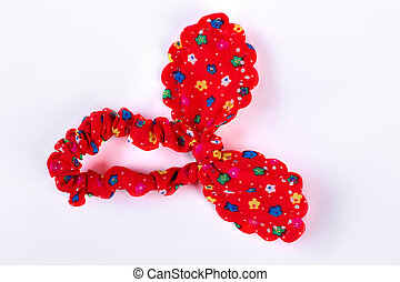 Red textile hair scrunchy with a pattern of flowers.