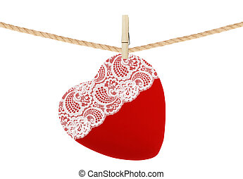 red textile heart with lace hang on clothespin isolated on white background